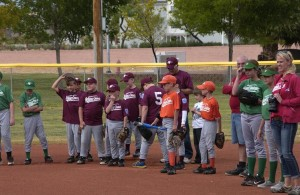 Players line the bases during the ceremony. Photo by Burton Weast.