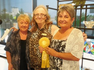 Bunny Wiseman, right, accepts her Sponsors Choice ribbon from  Sabine Reid, left, of Bank of Nevada and VVAA president Jean Wiensch. Photo by Linda Faas.