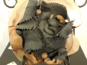 Snug in their leafy nest, Judith Hetem's sleeping clay squirrels took Honorable Mention. Photo by Linda Faas.