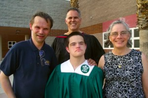 Front:  Ken Fergus, Sammy Fergus and Debbie Fergus. Rear:  Special Education Teacher, Mr. John Roesch.  Sammy Fergus, a special education student, graduates from Virgin Valley High School on June 4, 2015.  Proud Parents Ken and Debbie Fergus couldn't be more excited to see Sammy walk across the stage and receive his diploma. Photo by Teri Nehrenz.