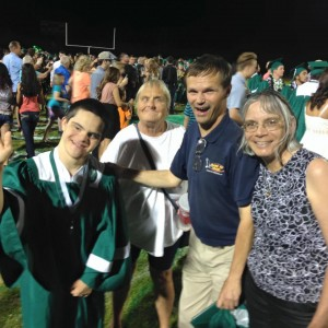 Sammy Fergus smiles big after the experience and achievement of a lifetime.  Fergus received his high school diploma on June 4, 2015 from Virgin Valley High School. Family friend, Judy Thurman and Proud Parents Ken and Debbie Fergus are there to celebrate the moment with the 2015 graduate. Photo by Lois Birnstihl Clayton.