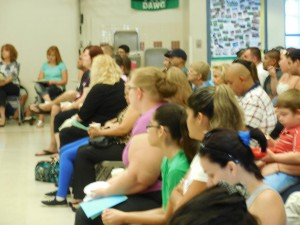 Attentive parents listened to VVES staff as they explained what the students would do during their summer classes. Photo by Linda Faas.
