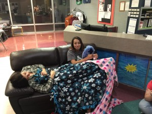 Not everyone could make it through the night. These two graduates take a breather to regain their energy last Thursday. Photo by McQuade Chesley.