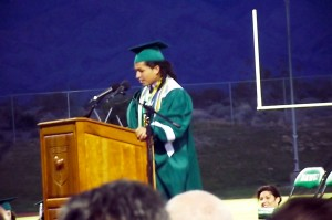 Virgin Valley High School Student Body President and Class of 2015 Salutatorian, Gabriel Rico Medina, gives a witty farewell speech to teachers, parents, coaches and especially to his fellow classmates thanking each and every one who both supported and challenged him along the way. Photo by Teri Nehrenz.