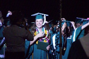"Graduating seniors are thrilled to turn the tassels, a traditional move which signifies the transition from student to young adult.  ""Turning the tassel from one side to the other seems like turning another page in one's life."" - See more at: http://www.graduationgown.com/fyi-tassels.html#sthash.kK1XsN9t.dpuf. Photo by Teri Nehrenz."
