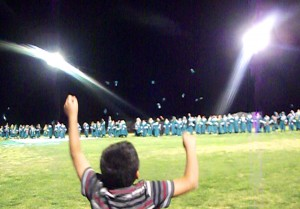 Family members, even the young siblings cheer and shout as the Class of 2015 throw their hats in the air as their final tribute and farewell to the halls of the Virgin Valley High School.