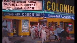 Screen shot of audience fleeing from the theater. Jack Harris cameo, center in sports coat and black tie - Fairview Productions.