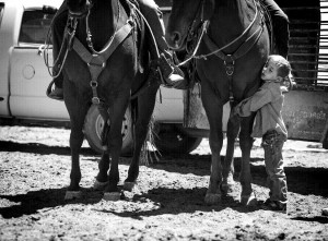 Giovanni Berg,6, gives love to a horse before branding begins. Giovanni is named for his great-great-grandfather, Giovanni Fallini, an Italian immigrant who moved to Nevada from Italy in the 1860s and began Twin Springs Ranch. PHOTO BY JEFF SCHEID