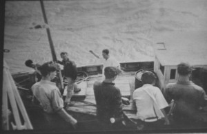 The Korean fishing boat and crew that saved Hardway and seven others.  The photo was taken from the HMS Alacrity deck.  The person holding the mast is one of the saved airmen preparing to disembark. Courtesy photo.