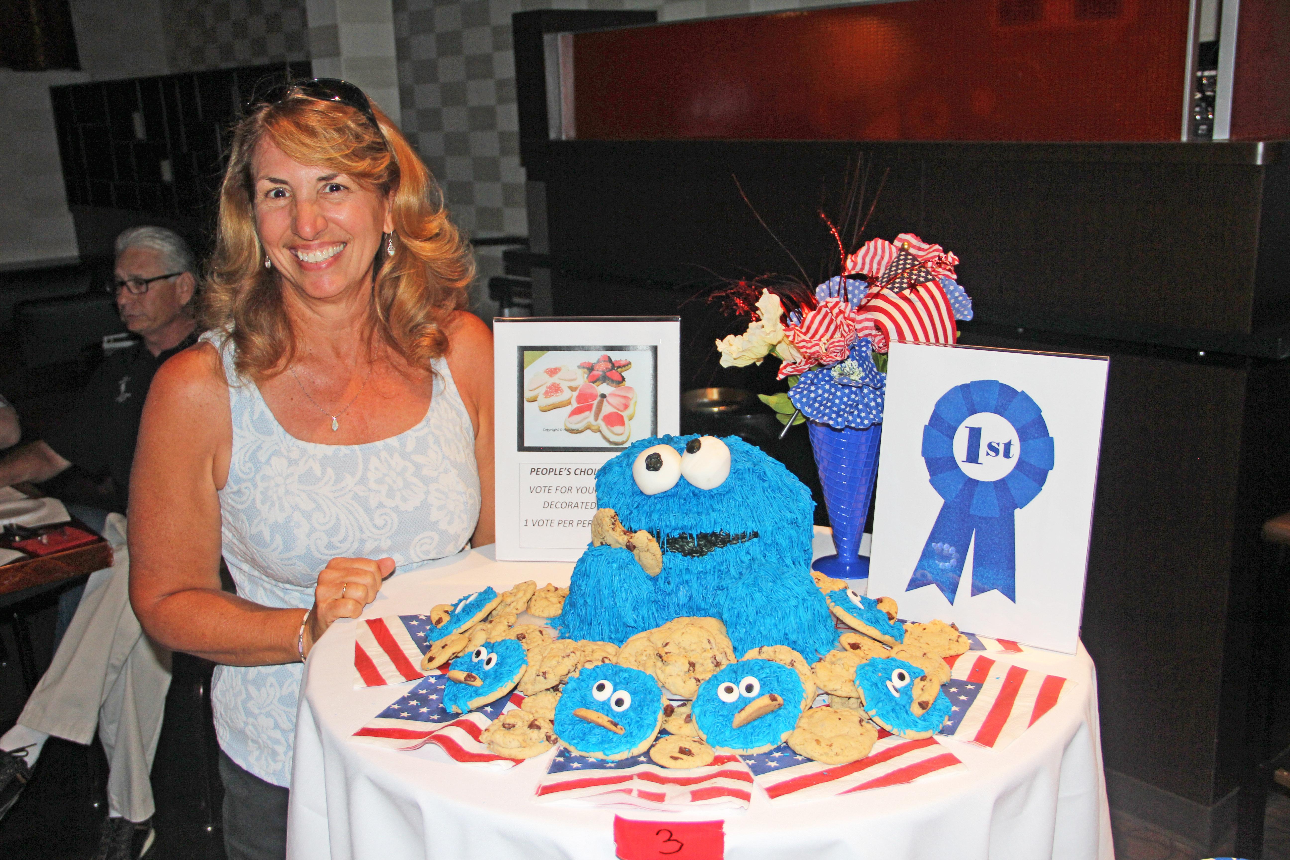 Kids for Sports' Nancy Hewett takes cookie awards