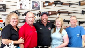 """Guns and Guitars is in the transitional period of moving into the next generation of business. From left to right are current owners Jan and Mike Sullivan, future owners Chris Sullivan with his girlfriend Jenny Perry, and the store's Jack of All Trades, """"Jersey Mike"""" Wilbur. Photo by Stephanie Frehner."""