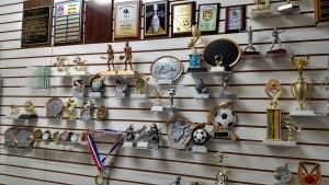 Charlie Sellner has taken great pride in his trophy collection, with this only being a portion of what his supplier provides him for local customers. Photo by Stephanie Frehner.