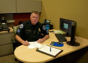 Sergeant Van Houten at his desk at the Mesquite Police Department in 2015. Photo by Burton Weast.