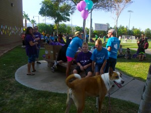 Kyan and Kyra Monson joined in the Walk to raise suicide awareness. Kyan (Left) was the official lap counter for the 2015 Walk in Memory/Walk for Hope. While they were waiting for the walk to begin they enjoyed Tank Nehrenz (four legged guy in the front) who also came out to help support suicide awareness and cheer the crowd. Photo by Teri Nehrenz.
