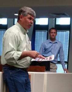 Rick Patton, left, and Derek Bruton of GDA Engineers explain the process of developing an Airport Master Plan for the Mesquite Municipal Airport to a small group of local residents and aviation enthusiasts at a public meeting on Tuesday, Sep. 15. Photo by Barbara Ellestad.