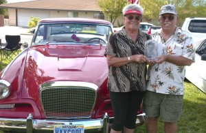 Jayne and Tom Fulton with their trophy and restored 1962 Studebaker Gran Turismo Hawk.