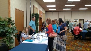 Leanne and Paul Chandler, owners of The Lindi Corp, talk with prospects who may be interested in working with their company on Monday at the second 'Putting Mesquite Back To Work' Job Fair held at the Casablanca Casino Resort. Photo by Stephanie Frehner.