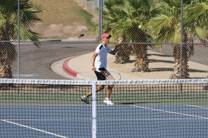 German exchange student Simon Kahlert returns a Chaparral serve during the Dawgs 3-1 win. Kahlert won all three sets to stay unbeaten. Photo by Lou Martin.