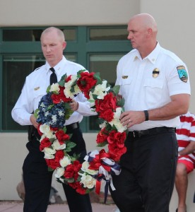 Mesquite's Police Dept Deputy Chief Scott Taylor, left, and Fire Dept Chief Kash Christopher lay a memorial wreath on the podium at Friday evening's Exchange Club of Mesquite 9-11 remembrance ceremony. Photo by Barbara Ellestad.