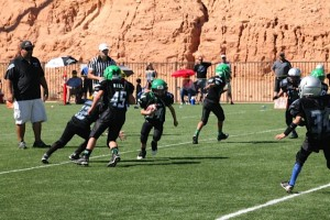 Maverick Ludvigson heading up field on the counter play with a lead blocker Daxton Noel. Submitted photo.