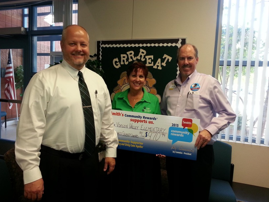 Mesquite's Smith's Food and Grocery presented a check for $970.94 to the Virgin Valley Elementary School through their Community Rewards Program. Pictured from left, Matt Bennett and Cathy Davis from Virgin Valley Elementary School and Craig Demos, Smith's Assistant Store Director. Photo submitted.