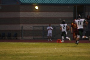 Bulldog wide receiver Jarret Tietjen 32 scores on a 76 yard touchdown pass from Q.B. Hogan Fowles on the second play from scrimmage. The quick score powered the Dawgs to a 48-0 win over Del Sol Friday night in Las Vegas. Photo by Lou Martin