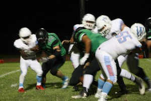 Bulldog linebacker Arden Bundy #65 led a Dawg swarming defense to shut down the Warriors. Bundy forced a fumble and took it in from 25 yards out to give the Bulldogs their last T.D. of the night. Photo by Lou Martin