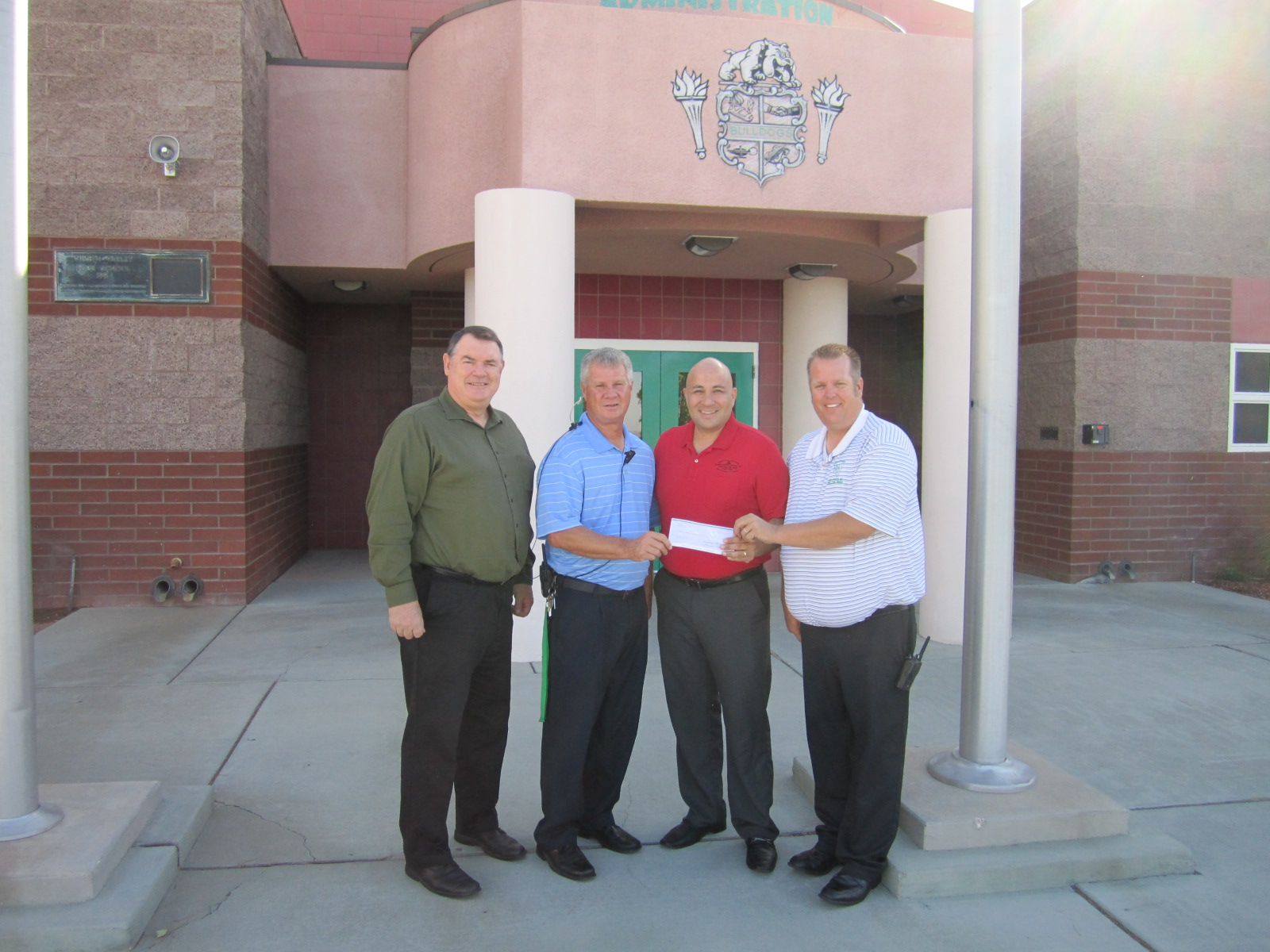 OPD Presents Checks To Local Schools From 'Round-up for Education' Program