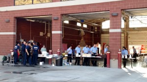 It was quite clear last Saturday that there were two kinds of crews at the pancake breakfast; current crews in dark blue and potential future crew in light blue. Both were eager to talk with attendees. Photo by Stephanie Frehner.