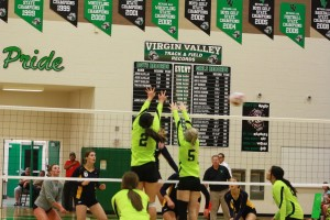 Bulldogs Bernice Fiso #2 and Mikayla Brotherson # 5 sky, blocking an Eagles shot, during the Bulldogs 3-1 win Monday night in the Dawg House. Photo by Lou Martin
