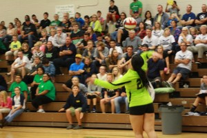Lady Dawg Janella Fiso serves up one of her 13 aces during the Dawgs 3-1 win over Boulder City Monday night in the Dawg House. Photo by Lou Martin