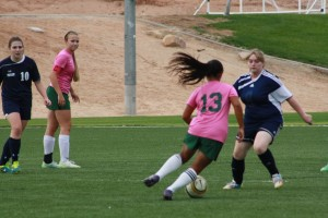 Bulldog Marlene Quiarte #13 dribbles her way through Eagle defenders to strike goal during the Dawgs 7-0 whitewash of Boulder City Wednesday at the MSEC.