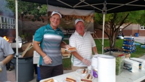 Wolf Creek General Manager Darren Stanek and Falcon Ridge Golf Course General Manager Brian Wursten serve up food prepared by one of the main cooks at The Terrace at Wolf Creek last Friday night at the VVHS Tailgate Party. Photo by Stephanie Frehner.