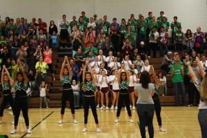 VVHS alumni and varsity cheerleaders lead the crowd in the schools fight song. Photo by Lou Martin