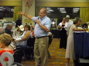 Nationally-recognized Tennessee Auctioneer Randy England provided entertainment as well as a true action experience during the Mesquite Madness charity Auction and Dinner which was hosted by the Exchange Club of Mesquite and held at the CasaBlanca Resort Sep. 26.  Photo by Teri Nehrenz.