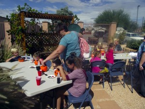 Colorful, non-toxic paints were provided to the younger children who couldn't handle knives or carving tools so they could still create their perfectly spooky Jack-o-Lantern for Halloween during the Pumpkin Carving event hosted by the Virgin Valley Heritage Museum on Oct. 17.  Photo by Teri Nehrenz.