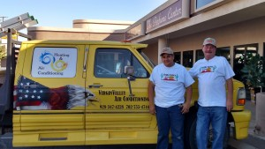 Junior Hernandez and Bill LaBronte stand next to their 'mobile' office that helps them service the Virgin Valley area. Photo by Stephanie Frehner