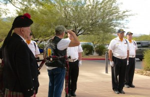 Mayor Litman salutes the Virgin Valley Honor Guard. Photo by Burton Weast.