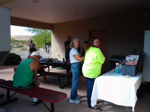 Dr. Peggy Purner and the Mesquite Veterinary Clinic held a low cost vaccine clinic at the Beaver Dam Fire Department in Littlefield, AZ on Oct. 3 which was well attended by Arizona Strip residents.  Photo by Teri Nehrenz.