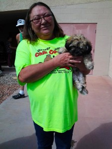 Dawn Hawkes walks away a happy pet owner after saving a little money getting her rescued puppy his first set of shots thanks to the low cost vaccine clinic sponsored by the Mesquite Veterinary Clinic and Dr. Peggy Purner which was held on Oct. 3 at the Beaver Dam Fire Station.  Photo by Teri Nehrenz.