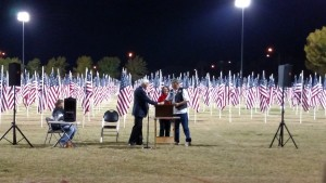 Exchange Club President Pam Gagnon, center, presents a check for $2,000 to Ken Maynard, President of the Mesquite Veterans Center, right, during the Veterans Day Ceremony on Nov. 11. Photo by Stephanie Frehner.