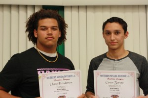 Bulldogs Chase Henderson, left, and Cesar Zarate receive their 1-A Sunrise all-conference honors Monday night, Nov. 16 at the annual football banquet. Photo by Lou Martin.