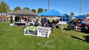 Benham is shown at the Nov. 7 Harvest Festival where he set up a demonstration table showing a backpack full of goodies that members are given once they have been accepted into the C.E.R.T. program. Photo by Stephanie Frehner.