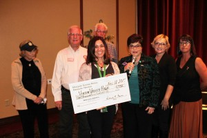 Virgin Valley High School counselor Christy Davis holds a donation check from the Sunrise Rotary for $1,750 presented to her at the Mesquite Chamber of Commerce Luncheon on Wednesday, Nov. 18. Photo by Barbara Ellestad.