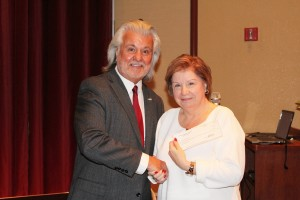 Ken Cook, left, President of the Mesquite Chamber of Commerce presents Gerri Chasko, Eureka Community Initiative Director, with a check for $1,513 that will benefit the summertime Mesquite Reads project at local elementary schools. Photo by Barbara Ellestad.