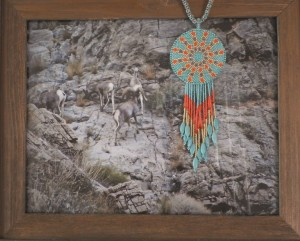 Wild West, David Bailey photo and Karron Knight beaded jewelry are one of the Lucky 13 Raffle prizes available at the Mesquite Fine Arts Gallery. Photo by Linda Faas.