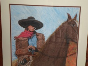 Trail Ride, a pastel art piece by Ralph LeMaster was donated by Jan Stensland for the Lucky 13 raffle at the Mesquite Fine Arts Gallery beginning Nov. 2. Photo by Linda Faas.