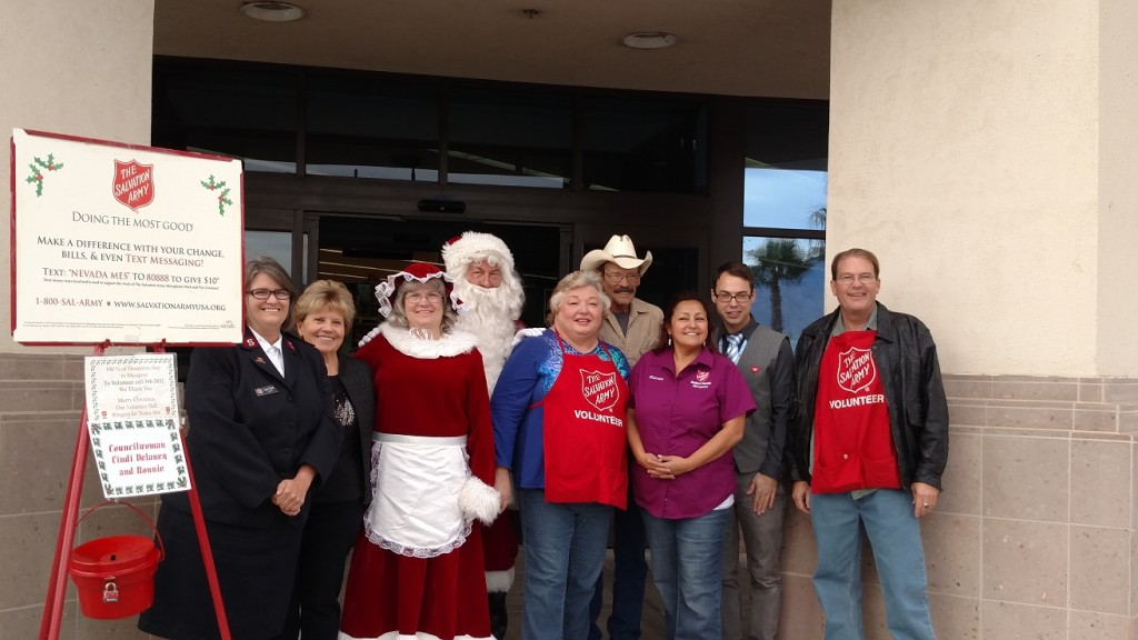 Kicking off the 2015 Red Kettle Drive are, from left to right, Lisa Smith, Captain with the Clark County Salvation Army, Claudia Carlsen, Mrs. Claus, Santa Claus, Councilwoman Cindi Delaney and her husband Ronnie, Mesquite Salvation Army Director Roberta Franco, Mesquite Walgreens Manager Nick Reber and Joe McIntyre. Photo by Stephanie Frehner