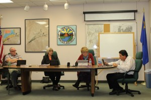 Virgin Valley Water District Board Members listen as Acting President Barbara Ellestad presents her statements on a Sept. 8 meeting she had with Lt. Governor Mark Hutchison. From left to right are Rich Bowler, Sandra Ramaker, Ellestad and Bubba Smith. Photo by Stephanie Frehner.