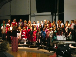 Bowler Elementary School Choir, directed  by Kathy McCann, sings about a lot of things for Christmas but mostly socks during the 19 Annual Festival of Trees which was held at the CasaBlanca Event Tent Nov. 18-21.  Photo by Teri Nehrenz.